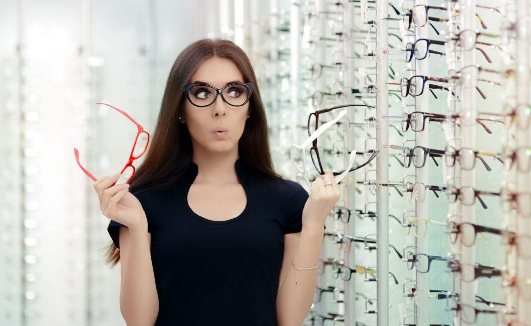 woman choosing eyeglasses - picture by nicoletaionescu http://www.123rf.com/profile_nicoletaionescu
